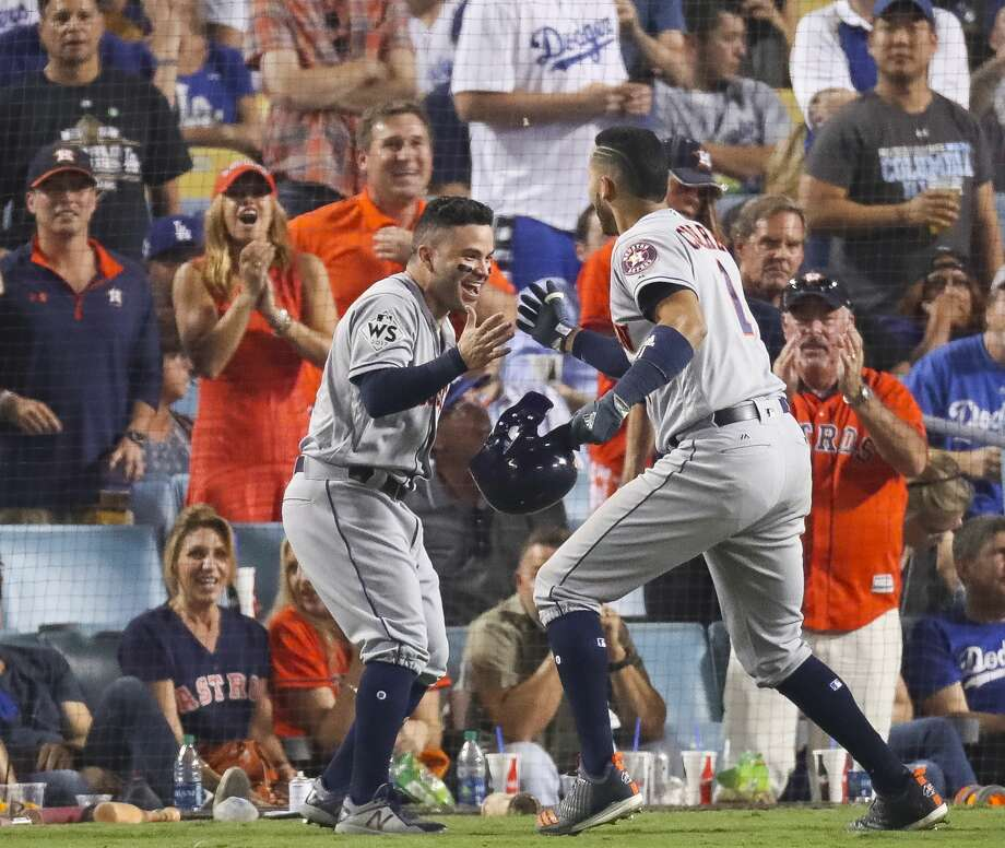 Jose Altuve and Carlos Correa, right, celebrate their back-to-back home runs in Game 2 of the World Series. Photo: Michael Ciaglo/Houston Chronicle