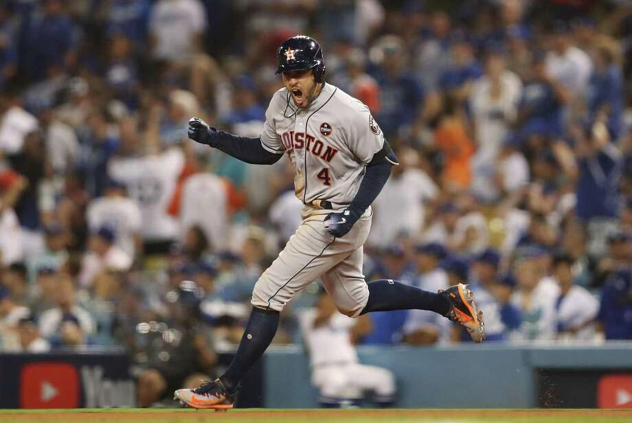 LOS ANGELES, CA - OCTOBER 25:  George Springer #4 of the Houston Astros runs the bases after hitting a two-run home run during the eleventh inning against the Los Angeles Dodgers in game two of the 2017 World Series at Dodger Stadium on October 25, 2017 in Los Angeles, California.  (Photo by Christian Petersen/Getty Images) Photo: Christian Petersen, Staff / Getty Images / 2017 Getty Images