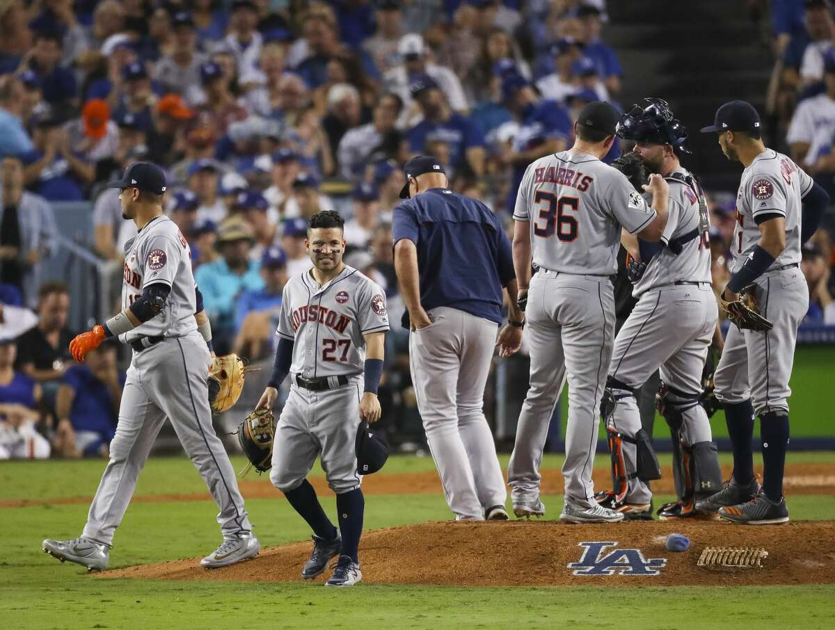 The Astros meet on the mound during the seventh inning of Game 2 of the World Series at Dodger Stadium on Wednesday, Oct. 25, 2017, in Los Angeles.