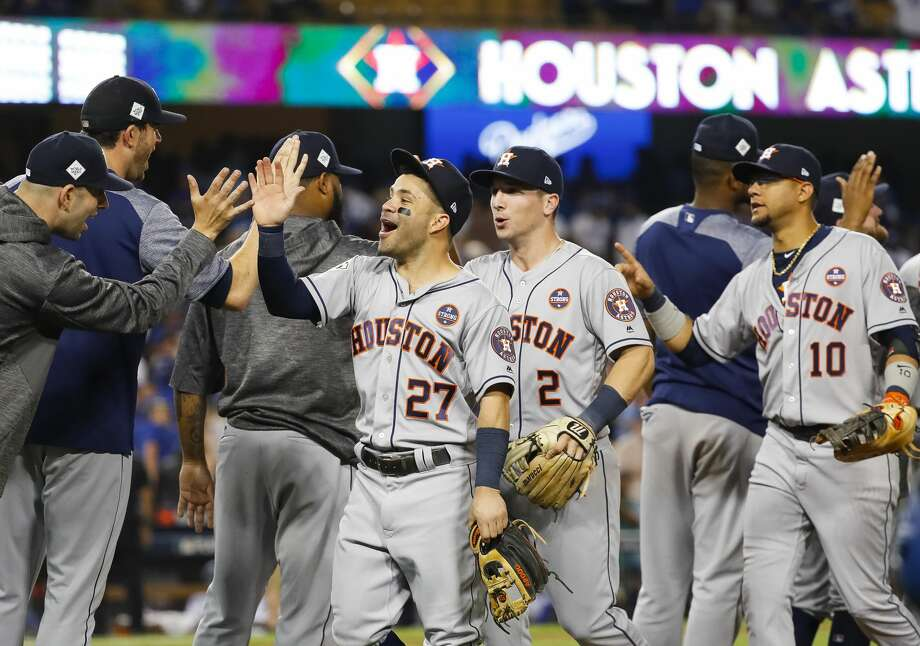 Houston Astros second baseman Jose Altuve (27) celebrates the Astros 7-6 win in the eleventh inning of Game 2 of the World Series at Dodger Stadium on Wednesday, Oct. 25, 2017, in Los Angeles. Photo: Karen Warren/Houston Chronicle