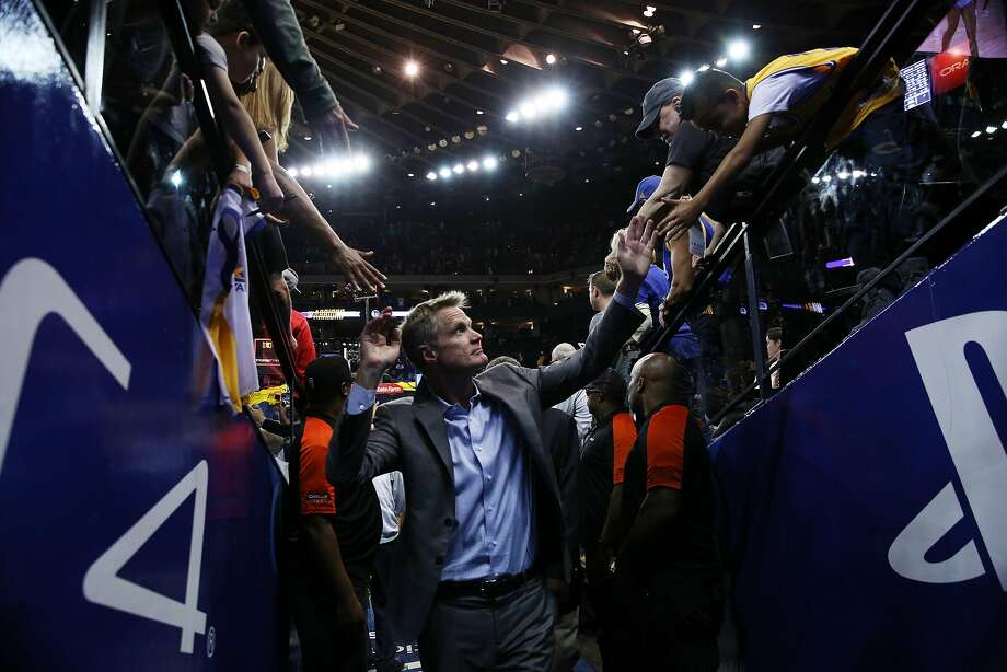 Golden State Warriors head coach Steve Kerr greets fans as he exits following the end of the NBA game between the Golden State Warriors and Toronto Raptors at Oracle Arena on Wednesday, Oct. 25, 2017, in Oakland, Calif. The Warriors won 117-112. Photo: Santiago Mejia, The Chronicle