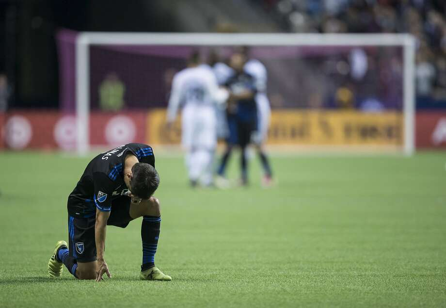 San Jose Earthquakes' Shea Salinas kneels on the field after losing to the Vancouver Whitecaps in the MLS playoffs. Photo: Darryl Dyck, Associated Press