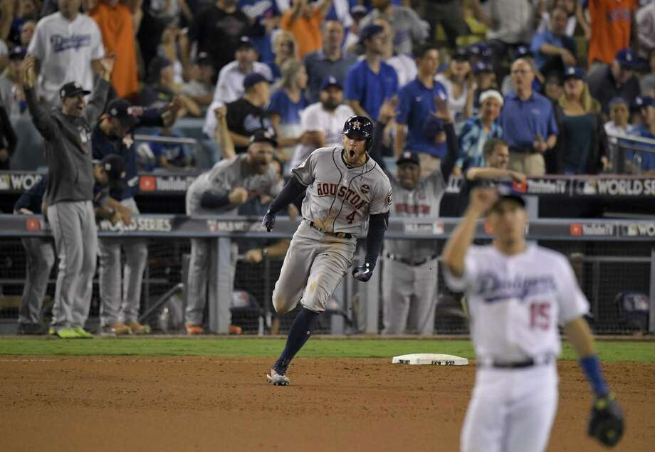 Houston outfielder George Springer celebrates his 11th-inning home run that gave the Astros the lead for good and a 1-1 tie in the World Series against the Dodgers. Photo: Mark J. Terrill / Mark J. Terrill / Associated Press / Copyright 2017 The Associated Press. All rights reserved.