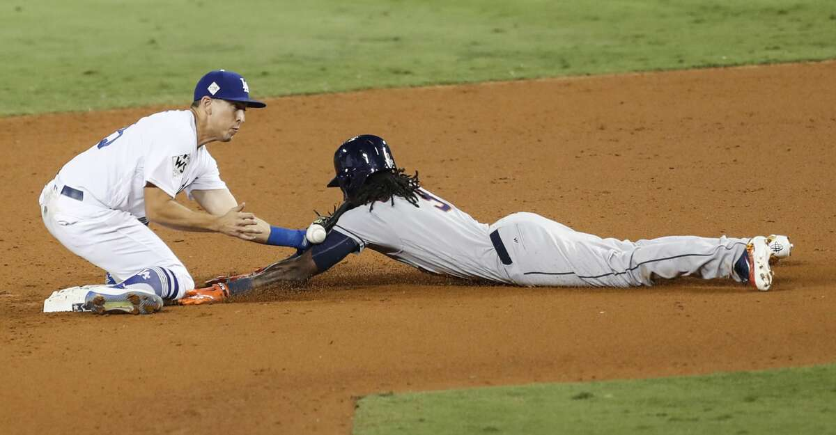 Houston Astros center fielder Cameron Maybin (3) steals second under the tag of Los Angeles Dodgers shortstop Corey Seager during the eleventh inning of Game 2 of the World Series at Dodger Stadium on Wednesday, Oct. 25, 2017, in Los Angeles. ( Brett Coomer / Houston Chronicle )