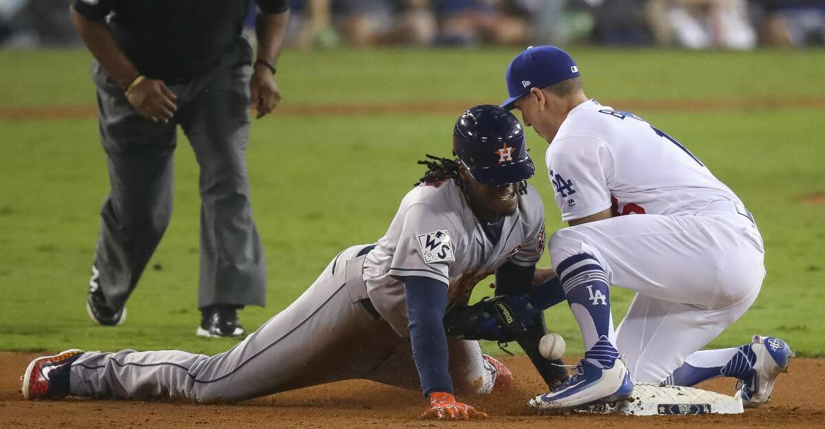 Cameron Maybin steals second during the eleventh inning of Game 2 of the World Series at Dodger Stadium on Wednesday, Oct. 25, 2017, in Los Angeles. ( Michael Ciaglo / Houston Chronicle )