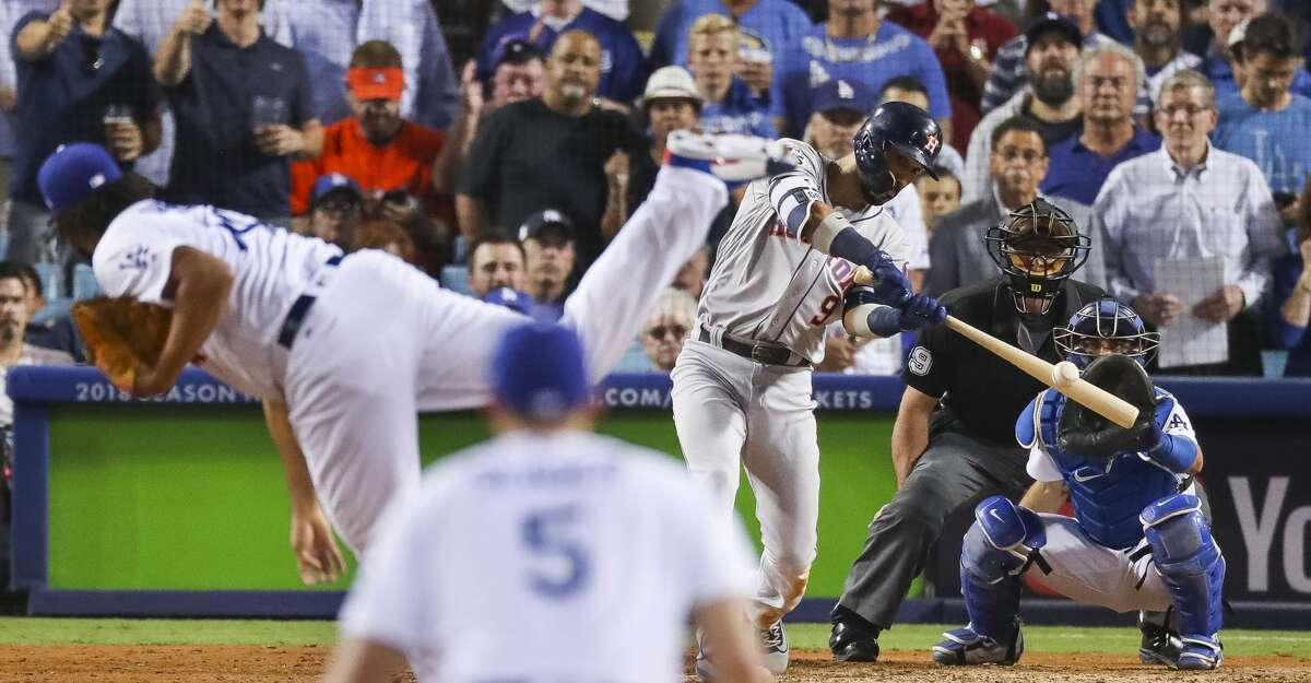 Houston Astros left fielder Marwin Gonzalez (9) hits a home run in the ninth inning of Game 2 of the World Series at Dodger Stadium on Wednesday, Oct. 25, 2017, in Los Angeles. ( Michael Ciaglo / Houston Chronicle )