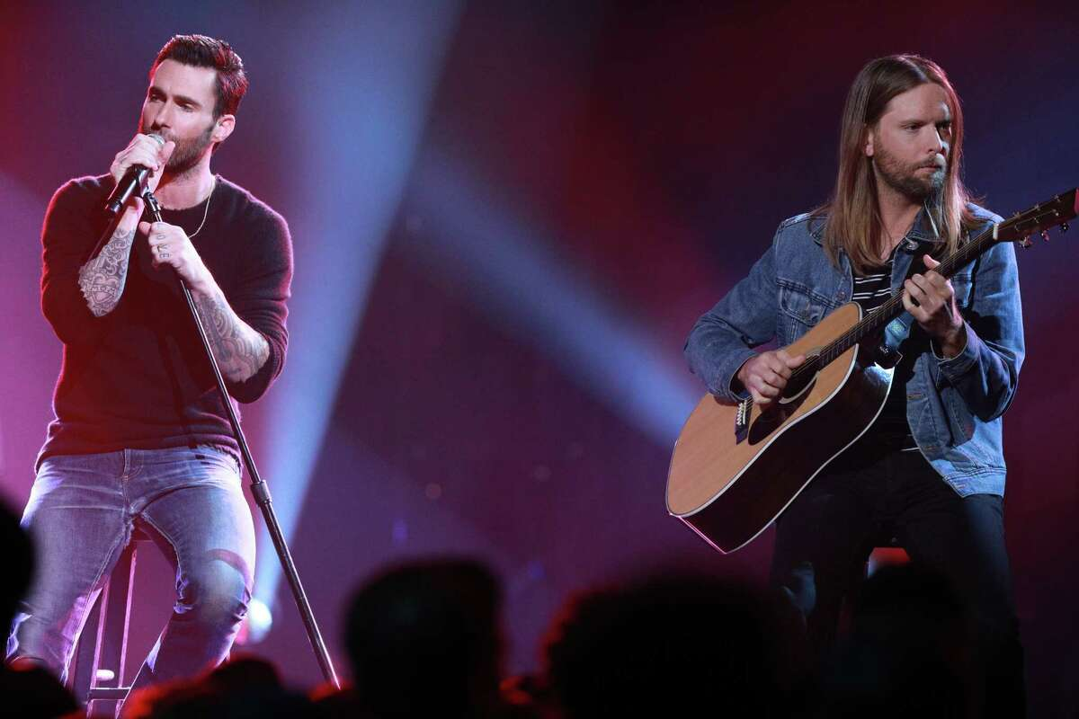 LOS ANGELES, CA - OCTOBER 14: In this handout photo provided by One Voice: Somos Live!, (l-r) Adam Levine and James Valentine of Maroon 5 perform onstage during