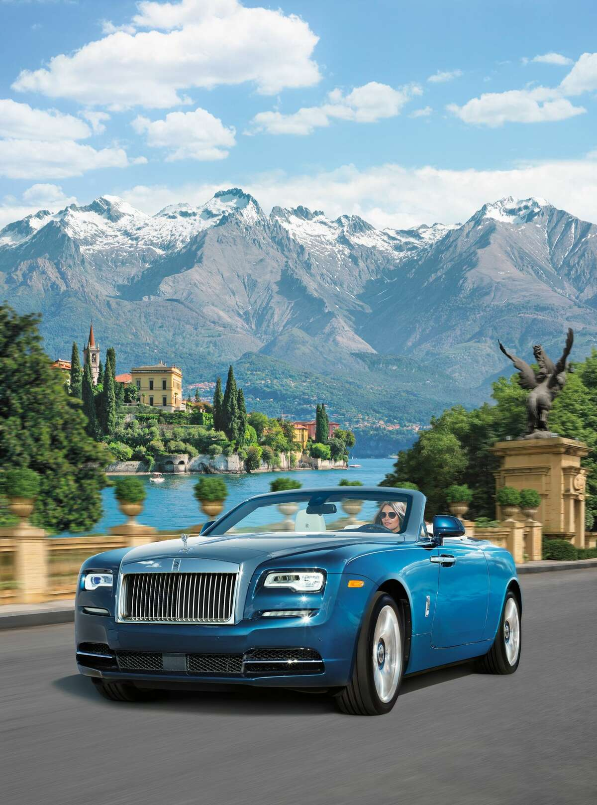 HIS CAR: Inspired by Lake Como, this V12-engined Rolls Royce Dawn boasts a crisp Selby Grey-and-black interior of hand-sewn leather, complemented by a brushed metal dashboard. PRICE TAG: $439,625