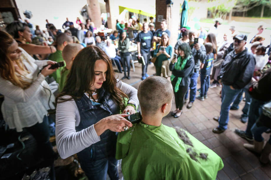 Jaci Chatham, of J. Hues Salon in Creekside, shaves a St. Balderick's participant's head on Sunday, March 12, 2017, at Goose's Acre in The Woodlands. Photo: Michael Minasi, Staff Photographer / © 2017 Houston Chronicle