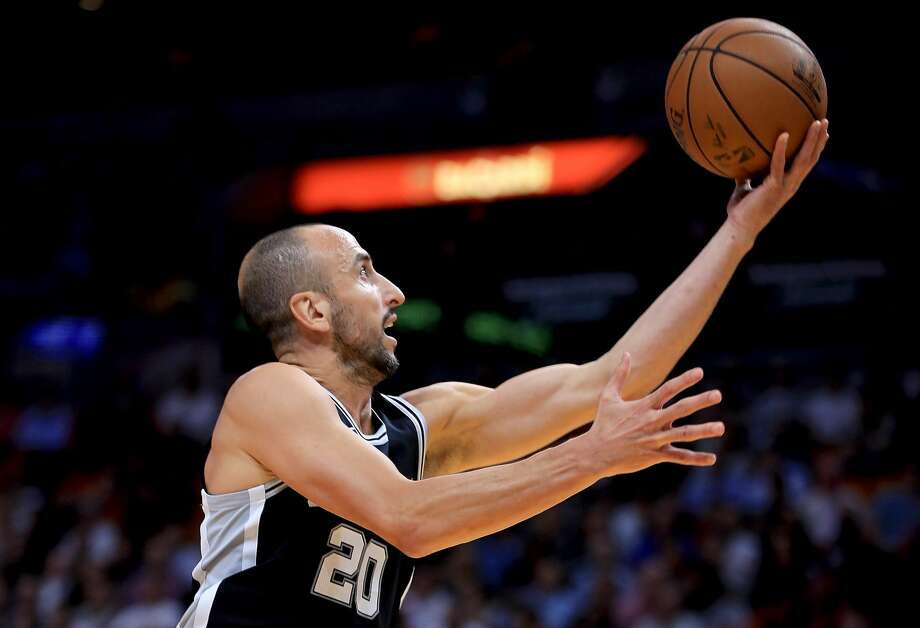 Manu Ginobili (20) of the San Antonio Spurs shoots during a game against the Miami Heat at American Airlines Arena on October 25, 2017 in Miami, Florida. (Photo by Mike Ehrmann/Getty Images) Photo: Mike Ehrmann/Getty Images