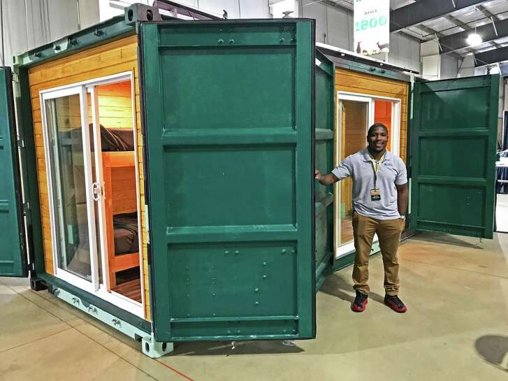 Aundrick Richard of Kountry Containers shows off the stealth design of his cabin that features an extra set of heavy-duty steel doors on the side that when open reveal two patio doors but when closed makes it look like a regular storage container.