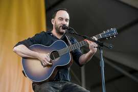 FILE - In this May 5, 2017, file photo, Dave Matthews performs at the New Orleans Jazz and Heritage Festival in New Orleans. Matthews and Metallica are headlining a Nov. 9, 2017, wildfire relief concert in San Francisco. (Photo by Amy Harris/Invision/AP, File)