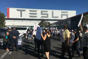 Pro-union Tesla employees rally outside the company's auto factory on Oct. 24. The United Auto Workers filed a complaint Wednesday with federal authorities accusing Tesla of firing workers for supporting the union.