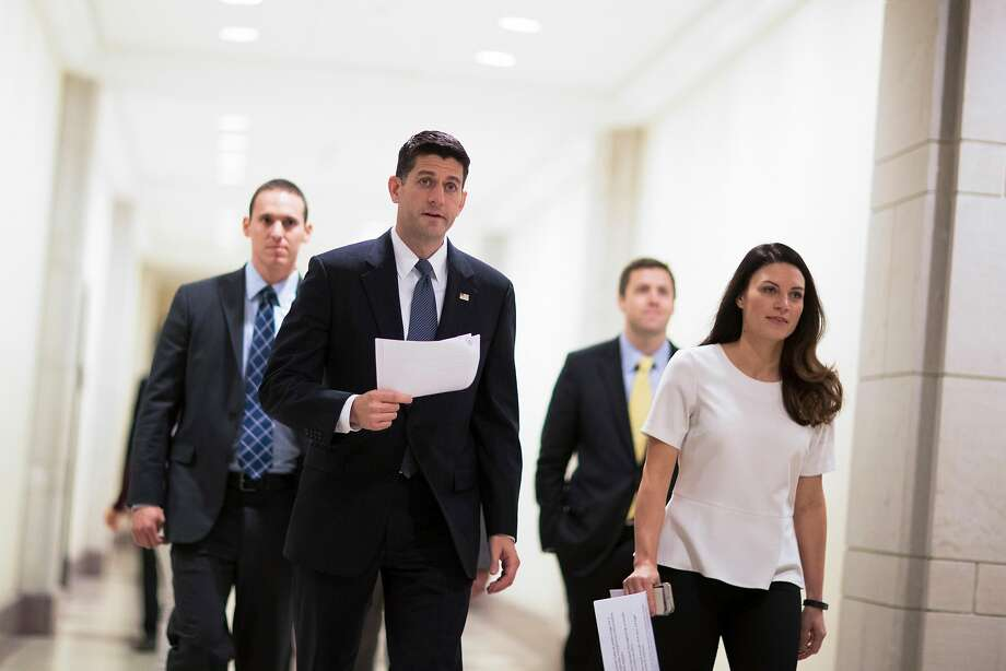 House Speaker Paul Ryan (R-Wis.) heads to his weekly news conference on Capitol Hill in Washington, Oct. 26, 2017. The House on Thursday sounded the starting gun on legislative efforts to cut taxes by as much as $1.5 trillion over the coming decade, narrowly clearing a budget blueprint that will allow a tax bill to pass Congress without any Democratic votes. (Tom Brenner/The New York Times) Photo: TOM BRENNER, NYT