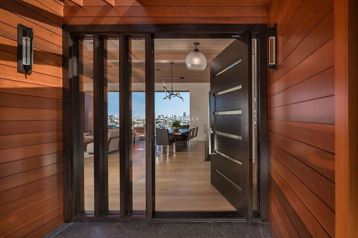 A mahogany door stands in the entryway.