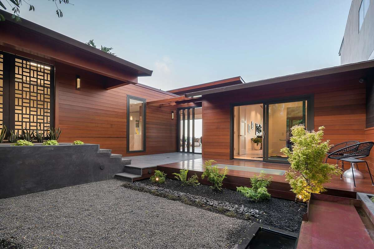 A Japanese courtyard stands before the four-bedroom home.
