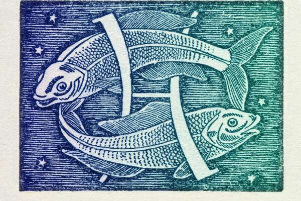 Pisces is the twelfth sign of the zodiac of western astrology, mobile and water; from 20 February to 20 March. Colored version of woodcut of 1942. Italy, Milan 2012. (Photo by Fototeca Gilardi/Getty Images)