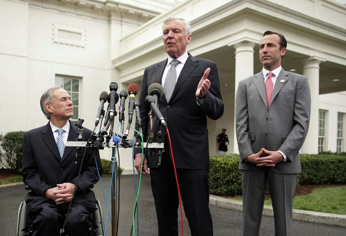 Charter Communications CEO Tom Rutledge (2nd L), Texas Gov. Greg Abbott (L) and Assistant to the President for Intragovernmental and Technology Initiatives Reed Cordish (R) participate in a news briefing outside the West Wing after an Oval Office announcement with President Donald Trump, on March 24, 2017, at the White House.