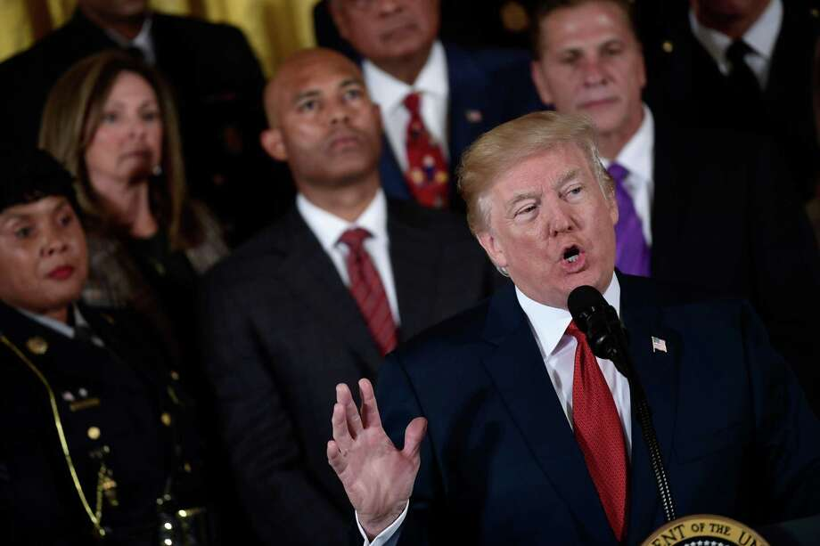 """US President Donald Trump delivers remarks on combatting drug demand and the opioid crisis on October 26, 2017 in the East Room of the White House in washington, DC. US President Donald Trump on October 26, 2017 is to declare the opioid crisis a """"nationwide public health emergency,"""" stepping up the fight against an epidemic that kills more than 100 Americans every day, officials said. / AFP PHOTO / Brendan SmialowskiBRENDAN SMIALOWSKI/AFP/Getty Images Photo: BRENDAN SMIALOWSKI, Contributor / AFP/Getty Images / AFP or licensors"""