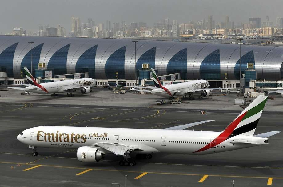 FILE - In this Wednesday, March 22, 2017 file photo, an Emirates plane taxis to a gate at Dubai International Airport at Dubai International Airport in Dubai, United Arab Emirates. Photo: Adam Scheck, Associated Press
