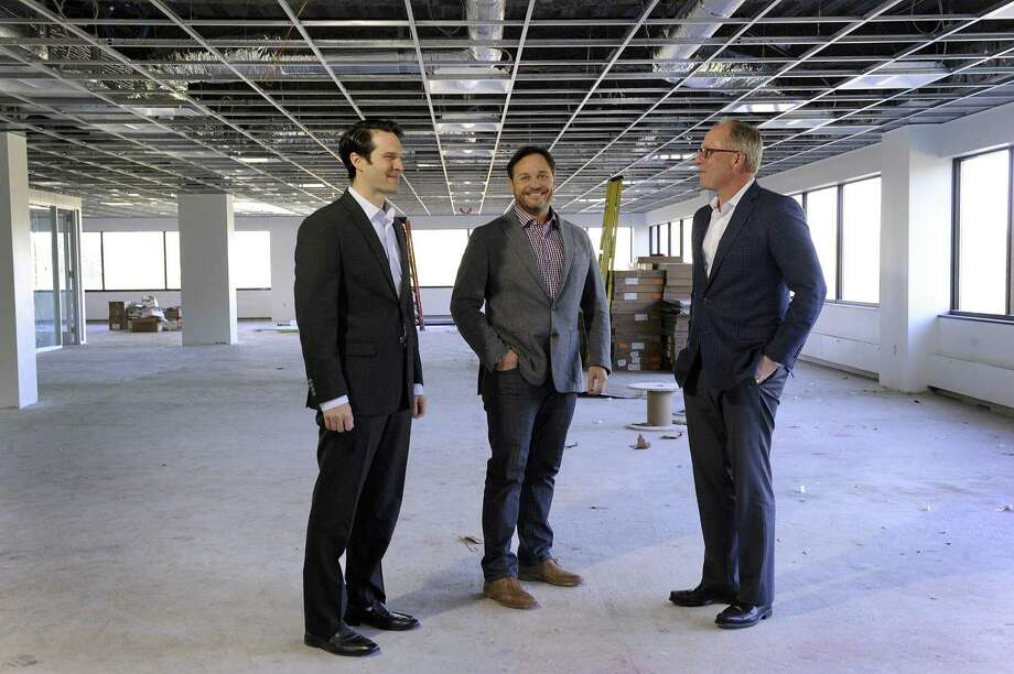 From left, Jay Lapham, portfolio manager for Allegiance Realty, Chris Smith, CEO and Todd Payne, who is the exclusive leasing agent for 44 Old Ridgebury Rd. in Danbury. They are standing in space that is being renovated for General Motors., Wed. Oct. 18, 2017. Photo: Carol Kaliff / Hearst Connecticut Media / The News-Times