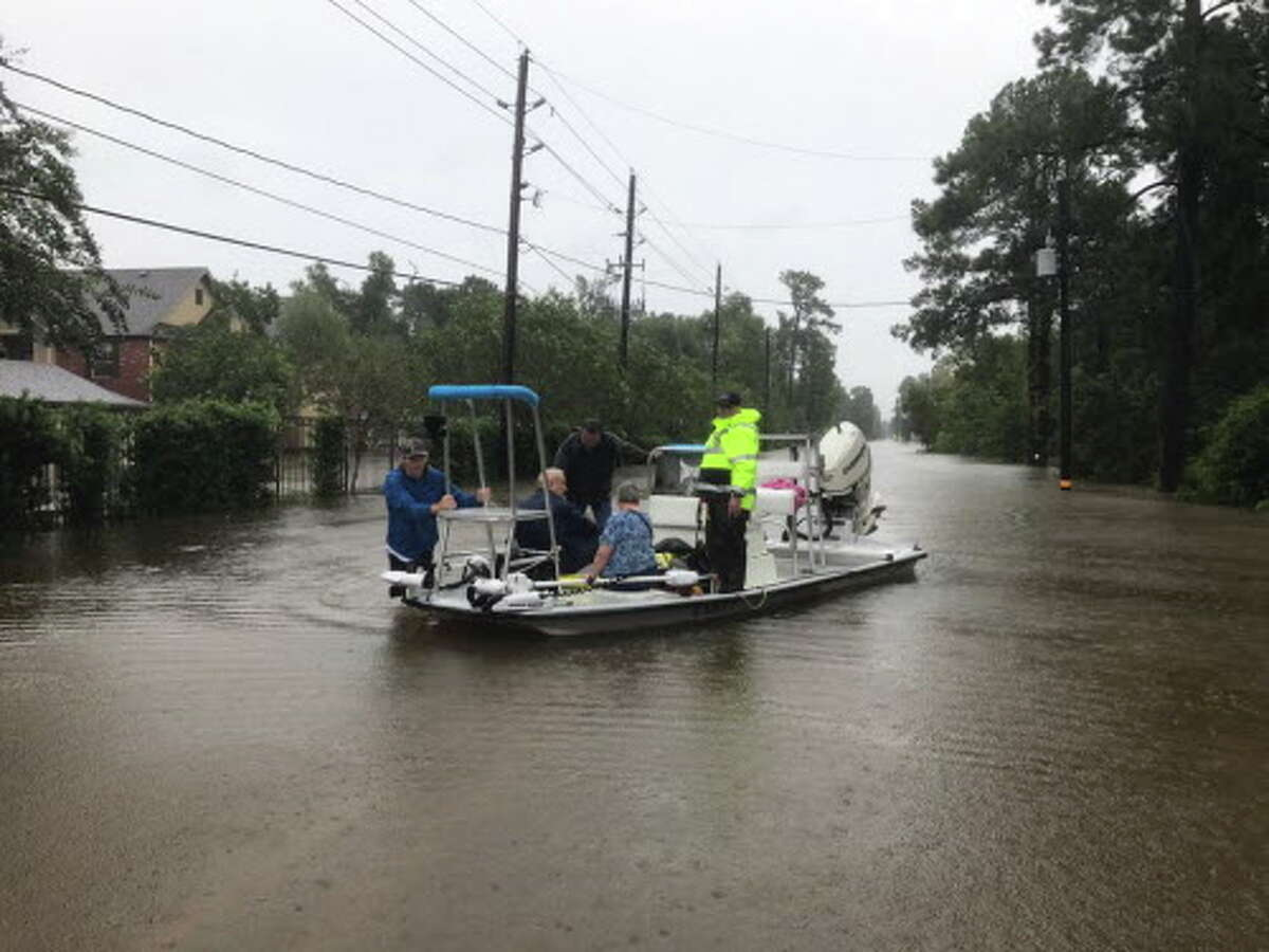 Precinct 3 Commissioner James Noack assists with high-water rescues with a team from the South Montgomery County Fire Department and Constable Precinct 3 Sgt. Christopher Hoffmeyer.