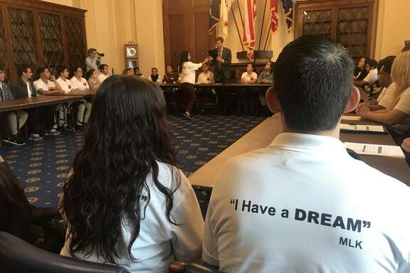 Dreamers Guendi Castro of Las Cruces (left) and Noe Labrado of El Paso (right) meet with Congressman Beto O'Rourke in a house hearing room on October 26, 2017