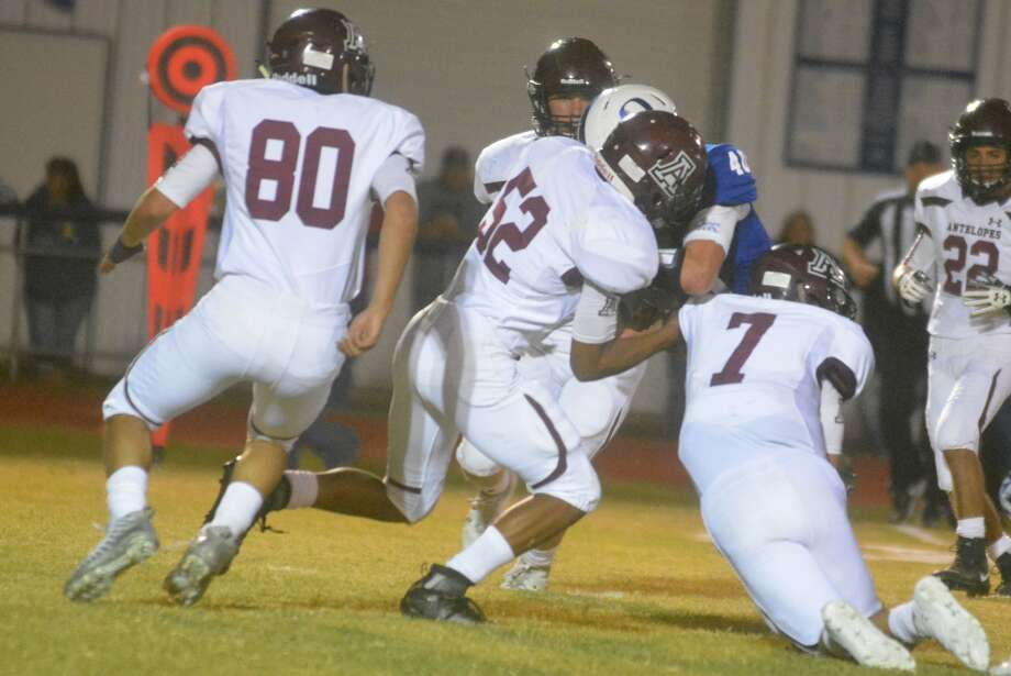 Abernathy defenders Adrian Macias, 7, and Dante Flores, 52, combine to tackle an Olton runner as teammate Kevan Vasquez, 80, moves in to help during a District 2-2A, Division I game in Olton last week. The unbeaten Antelopes will host Floydada Friday. Photo: Skip Leon/Plainview Herald