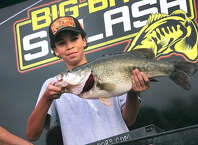 Jacob Sumrall, 12, of Kirbyville, holds up his 9.60-pound largemouth bass last Friday while weighing-in at the Big Bass Splash Fall Shootout event at Umphrey Pavilion on Lake Sam Rayburn. Sumrall's catch won him first place, his fifth Big Bass Splash event to participate in. (Photo provided by Nicole Sealy)