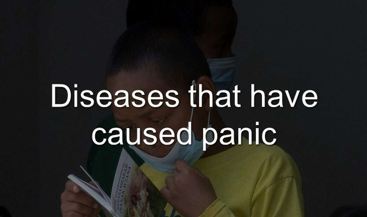 A girl wears a face mask inside a hospital in the capital Antananarivo, Madagascar. Action Against Hunger said Monday. Oct. 23, 2017 that more than 100 plague deaths have been reported since the outbreak began in August and that most of the nearly 1,300 reported cases of plague are of the pneumonic kind, a more virulent form that spreads through coughing, sneezing or spitting and is almost always fatal if untreated. Continue through the photos to see the diseases that have caused people to panic.