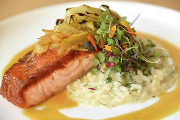 Pan roasted salmon with leek, orange, dill, greens, risotto, grilled fennel at District Kitchen & Bar on Thursday, Oct. 12, 2017 in Pittsfield, N.Y. (Lori Van Buren / Times Union)