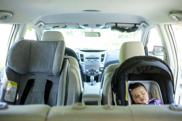 FILE-- A child in a rear-facing carseat in Pikesville, Md., June 25, 2015. Congressional lawmakers have been weighing whether to require new cars to include a device for detecting children in the back seat and warning the driver of their presence after the car has been turned off. (Matt Roth/The New York Times)