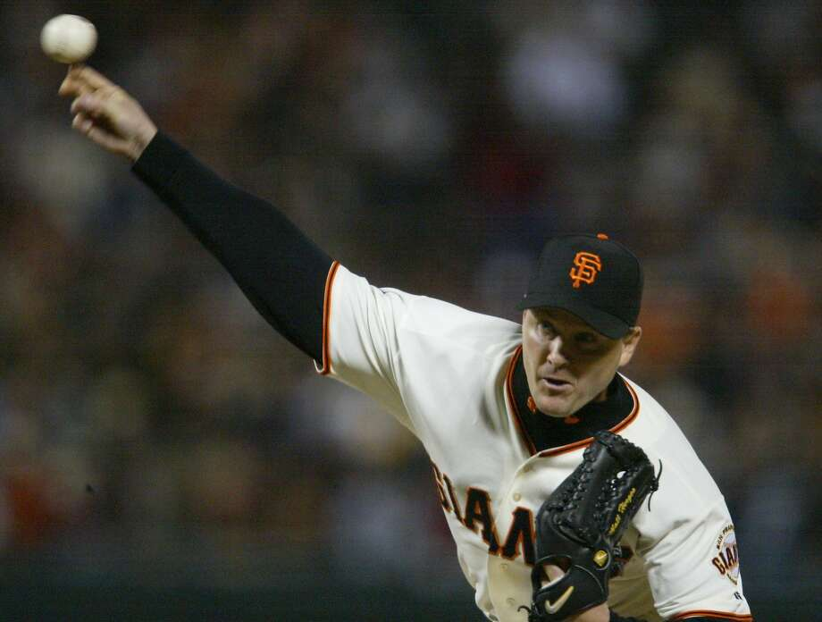 Pitcher Matt Herges pitches for the San Francisco Giants in 2003 against the Colorado Rockies. He is the new bullpen coach for the Giants in 2018. Photo: LIZ MANGELSDORF, SFC