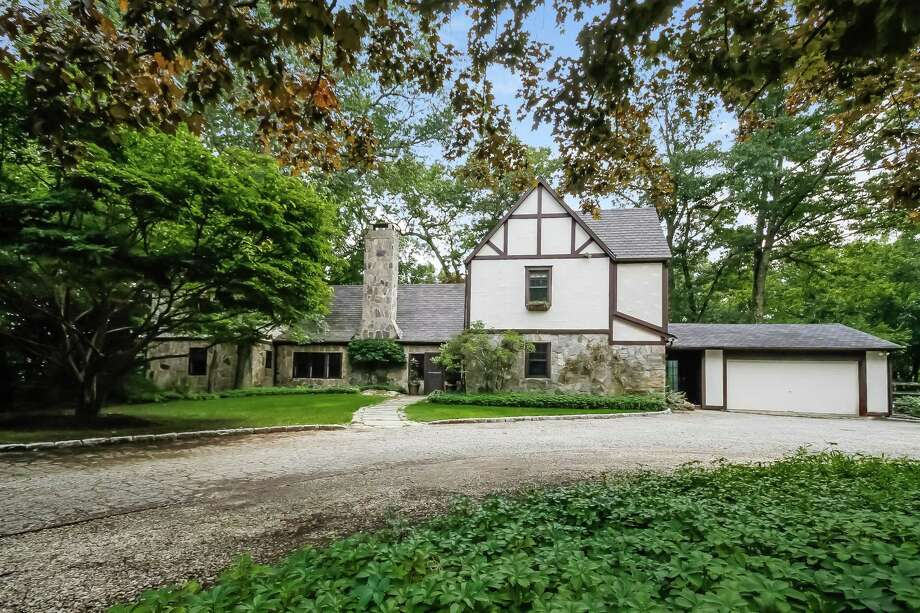 The French Normandy Tudor house at 12 Iron Gate Hill was designed and built in 1926 by famed local architect Frazier Peters. Photo: Contributed Photos / © 2017 PlanOmatic