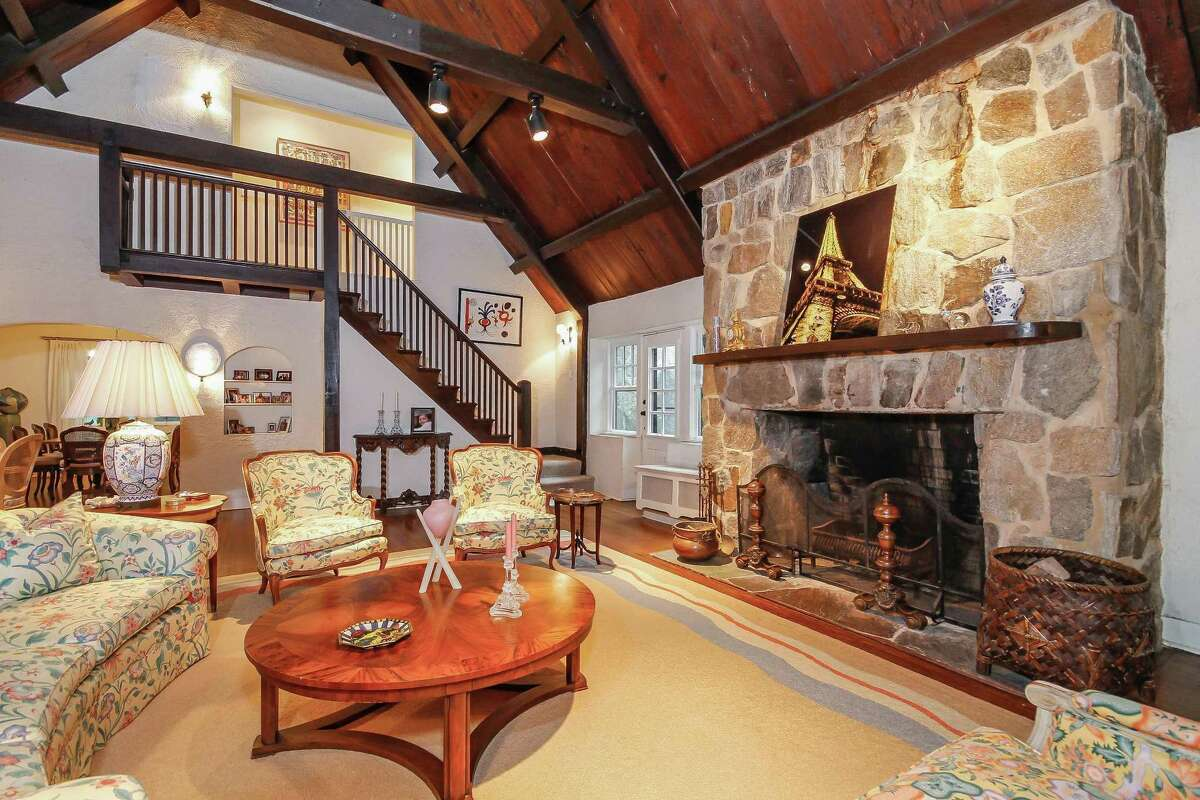 The living room is the heart of the home and features a fieldstone fireplace and cathedral ceiling covered in pecky cypress wood.