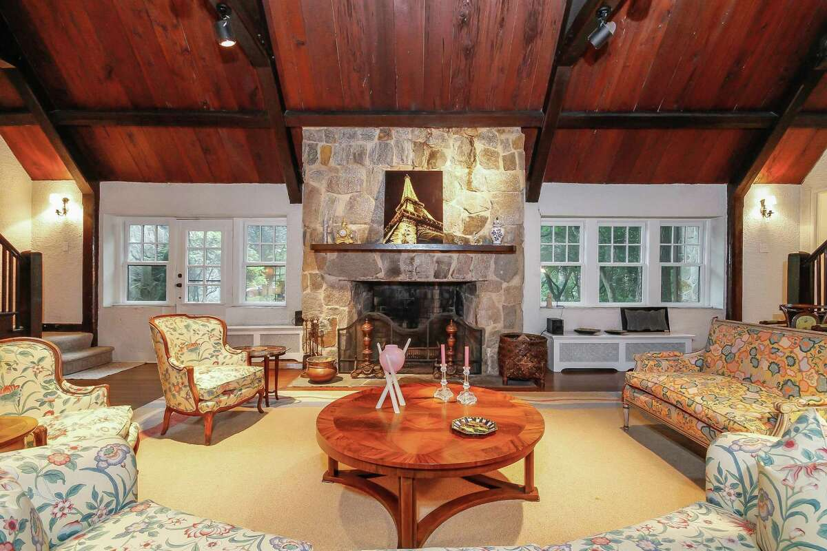 There is a massive floor-to-ceiling fieldstone fireplace in the living room.