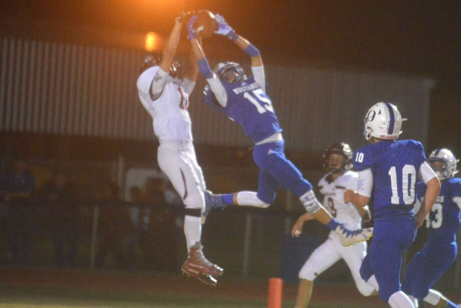 Olton's Noah Garza, 15, leaps high to intercept an Abernathy pass in the end zone during a District 2-2A, Division I football game last week. After two losses to start district, Olton will look to climb into the playoff race when they play Sundown Friday night. Photo: Skip Leon/Plainview Herald