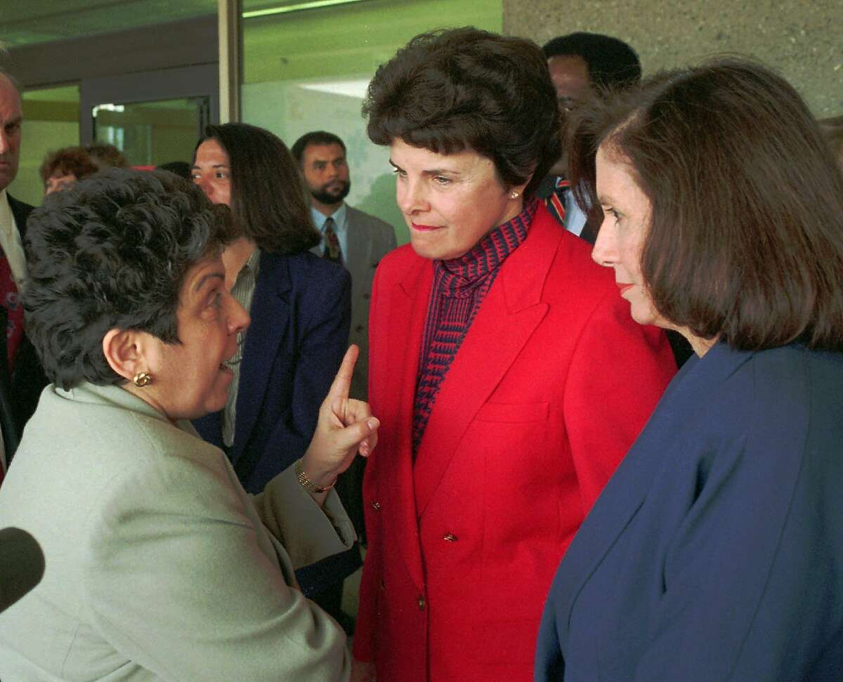 Secretary of Health and Human Services Donna Shalala, left, makes a point to U.S. Sen. Dianne Feinstein, D-Calif., center, and Congresswoman Nancy Pelosi, D-San Francisco, after touring San Francisco General Hospital and speaking with hospital administrators Friday, April 1, 1994. Feinstein and Shalala both emphasized the need for all states to follow new federal guidelines that make abortion accessible to poor women in cases of rape and incest. (AP Photo/Sam Morris)