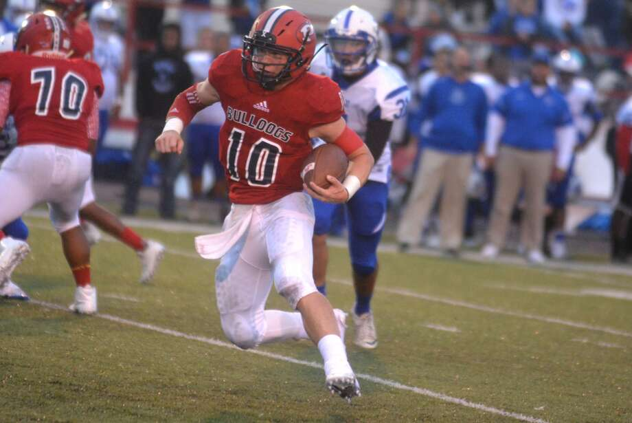 Plainview quarterback Carson Hauk runs for yardage in a game earlier this season. The Bulldogs return home for the first time in four weeks when they host Caprock in a crucial District 3-5A football game at Greg Sherwood Memorial Bulldog Stadium Friday night. Photo: Skip Leon/Plainview Herald
