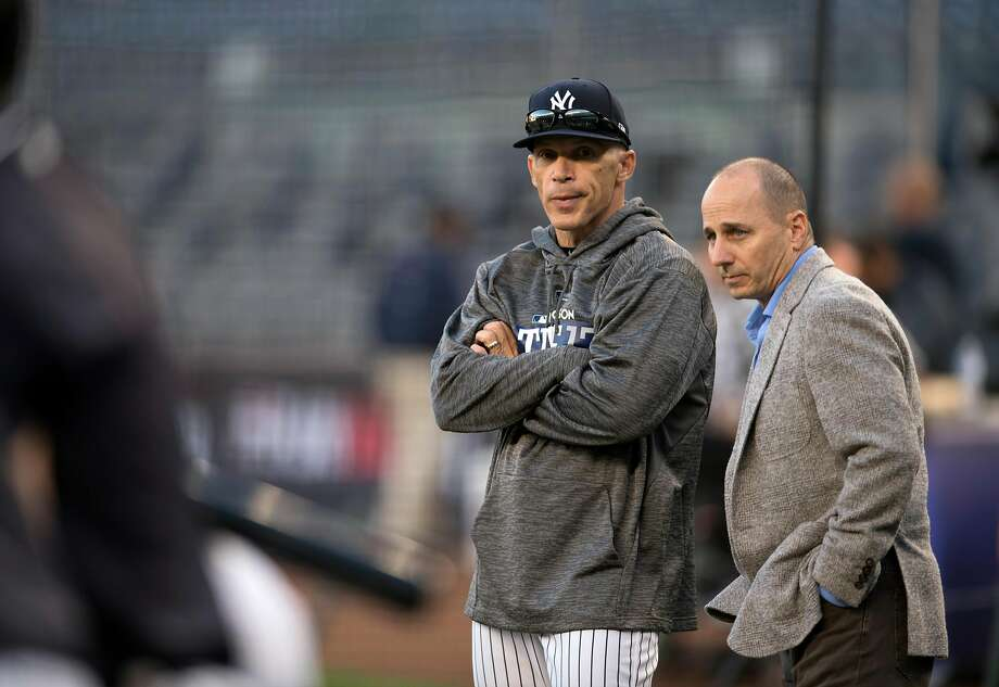 Joe Girardi (left) was fired as Yankees manager by general manager Brian Cashman (right) after 10 seasons. Photo: BEN SOLOMON, NYT