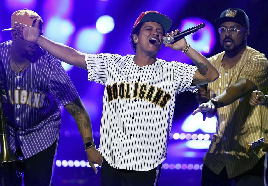 "Bruno Mars' 1990s-inspired ""24K Magic"" earned him six nominations, including placement in the big three races for the 60th annual Grammy Awards. Photo: Matt Sayles, Associated Press"