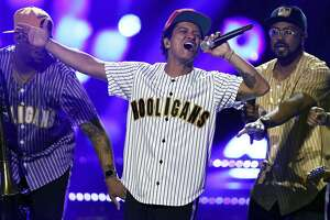 """FILE - In this Sunday, June 25, 2017, file photo, Bruno Mars performs """"Perm"""" at the BET Awards at the Microsoft Theater in Los Angeles. Mars is the top nominee with eight nods at the American Music Awards, while The Chainsmokers, Drake, Kendrick Lamar, Ed Sheeran and The Weeknd all earned five nominations each. The show will broadcast live from the Microsoft Theater in Los Angeles on Nov. 19 at 8:00 p.m. Eastern on ABC.  (Photo by Matt Sayles/Invision/AP, File)"""