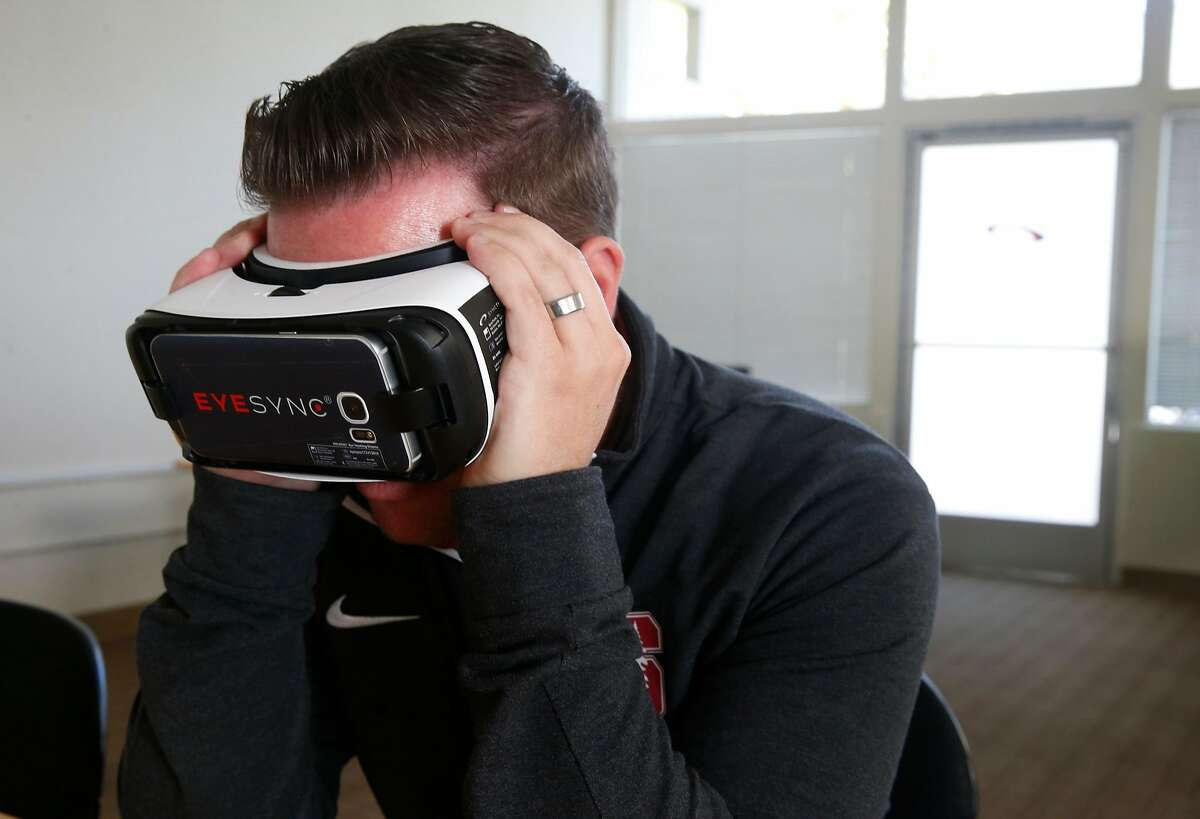 Scott Anderson, the chief customer officer at SyncThink and former director of sports medicine at Stanford, demonstrates the Eyesync optical scanner in Palo Alto, Calif. on Thursday Oct. 26, 2017 which tracks eye movements to determine if there's a level of impairment.