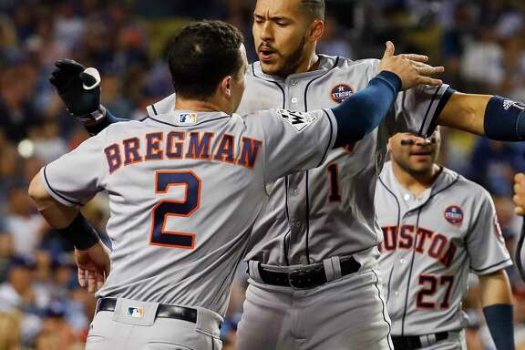 Third baseman Alex Bregman, left, and shortstop Carlos Correa are both 23 and should anchor the left side of the Astros' infield for many years to come.