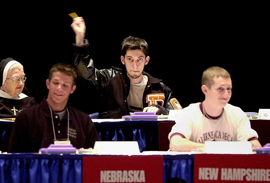 J. Frank Dobie High School's John Dokhani helped Dobie win the Super Quiz portion of the U. S. Academic Decathlon held Friday afternoon in Erie, PA.  HOUCHRON CAPTION  (04/27/2003):  Dobie High School's John Dokhani, a senior, helped the school's Academic Decathlon team to a third-place finish at the national championships on Saturday. The team, representing Texas at the national meet in Erie, Pa., finished behind schools from California and Wisconsin. Photo: Greg Wohlford
