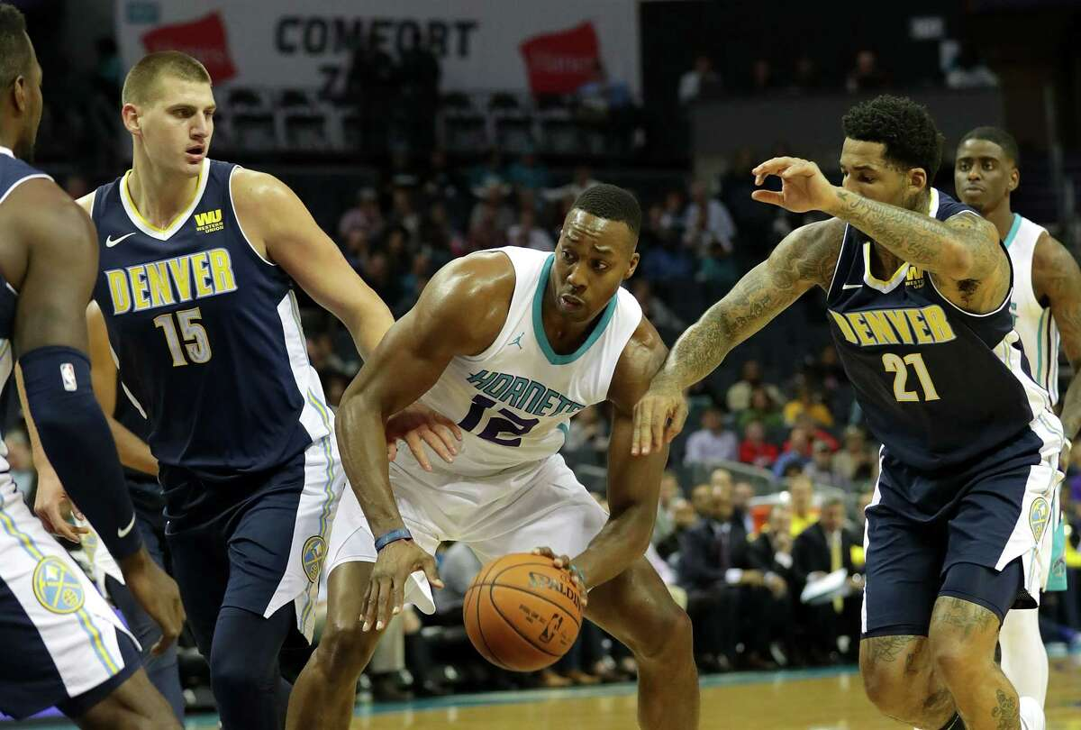 CHARLOTTE, NC - OCTOBER 25: Dwight Howard #12 of the Charlotte Hornets drives to the basket against teammates Nikola Jokic #15 and Wilson Chandler #21 of the Denver Nuggets during their game at Spectrum Center on October 25, 2017 in Charlotte, North Carolina. NOTE TO USER: User expressly acknowledges and agrees that, by downloading and or using this photograph, User is consenting to the terms and conditions of the Getty Images License Agreement.