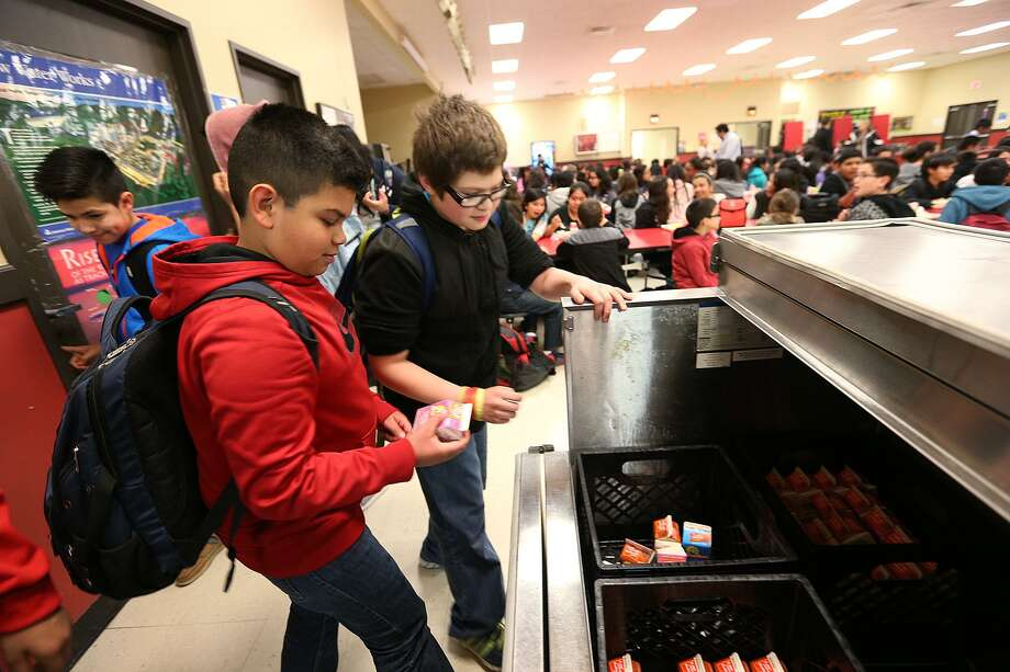 Six-graders Jesus Lopez, 11, left, and Bryson Keller, 12, at lunch in Losoya Intermediate School in 2015. Southside ISD's bond program will begin the work of converting Losoya into the district's second middle school. Photo: JERRY LARA /San Antonio Express-News / © 2015 San Antonio Express-News