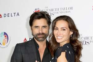 BEVERLY HILLS, CA - OCTOBER 24:  (EDITORIAL USE ONLY. NO COMMERCIAL USE)  John Stamos (L) and Caitlin McHugh attend The Elizabeth Taylor AIDS Foundation and mothers2mothers dinner at Ron Burkle's Green Acres Estate on October 24, 2017 in Beverly Hills, California.  (Photo by Rachel Murray/Getty Images for mothers2mothers and The Elizabeth Taylor AIDS Foundation )