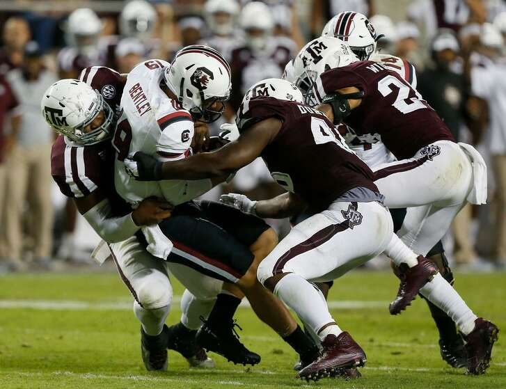 Jake Bentley #19 of the South Carolina Gamecocks is sacked by Landis Durham #46 of the Texas A&M Aggies in the fourth quarter at Kyle Field on Sept. 30, 2017 in College Station, Texas.