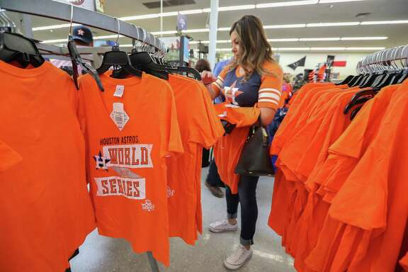Yesenia Robles shops for her family  new Astros World Series merchandise in the Academy Sports & Outdoor store 2404 Southwest Fwy, Tuesday, Oct. 24, 2017, in Houston. ( Steve Gonzales / Houston Chronicle )
